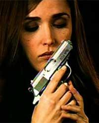 Ellen with a gun and dark eye make-up